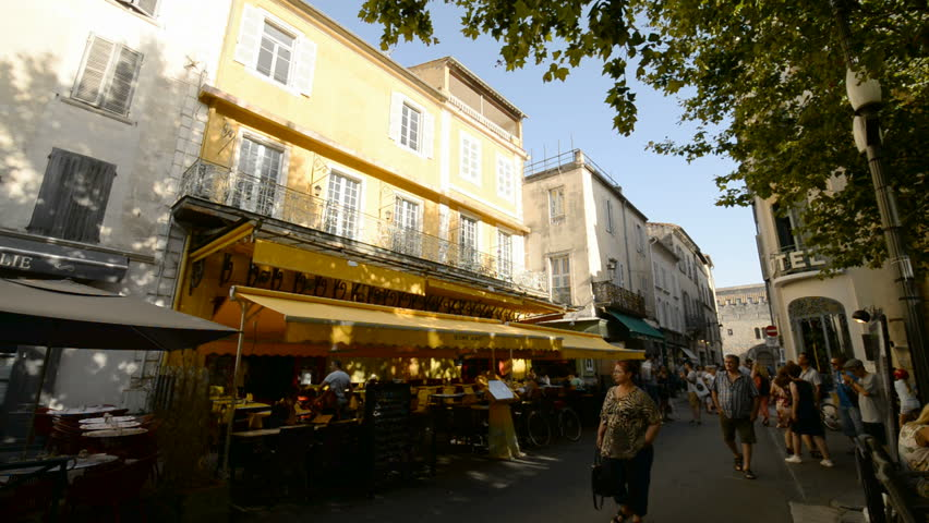 ARLES, FRANCE - 7TH JULY 2017: Tourists in the street and Van Gogh restaurant in the Arles, Provence, France, Europe.