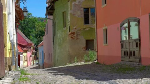 street in the old part of Sighisoara, the houses are painted in bright colors