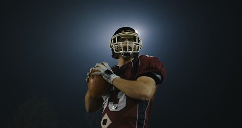 American footbal player practicing throwing and catching