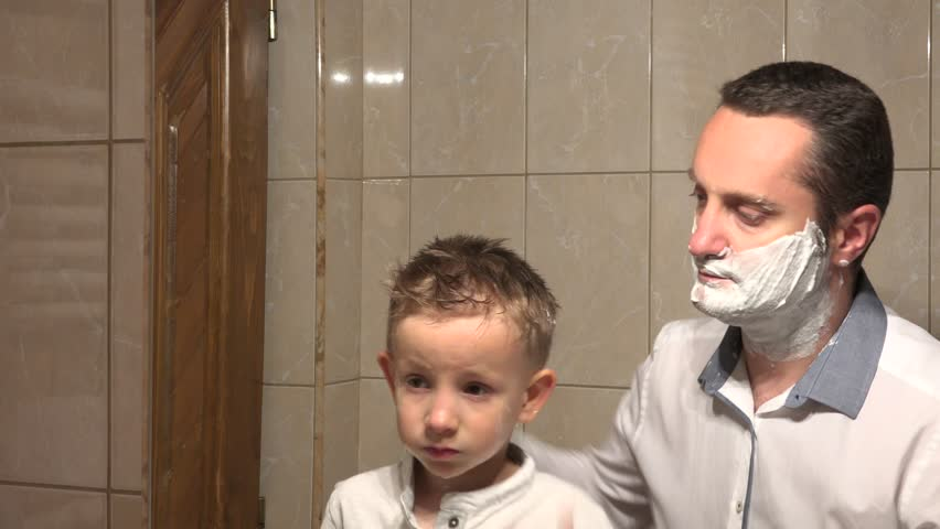 Stock Video Of Father And Son Looking On Mirror 1007525395