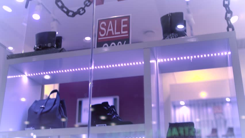 The letters are moving in the shop window. The Shoe sale | Shutterstock HD Video #1007547142