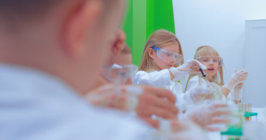 Teacher and students doing science experiment in school classroom. Children in chemistry class | Shutterstock HD Video #1007553379