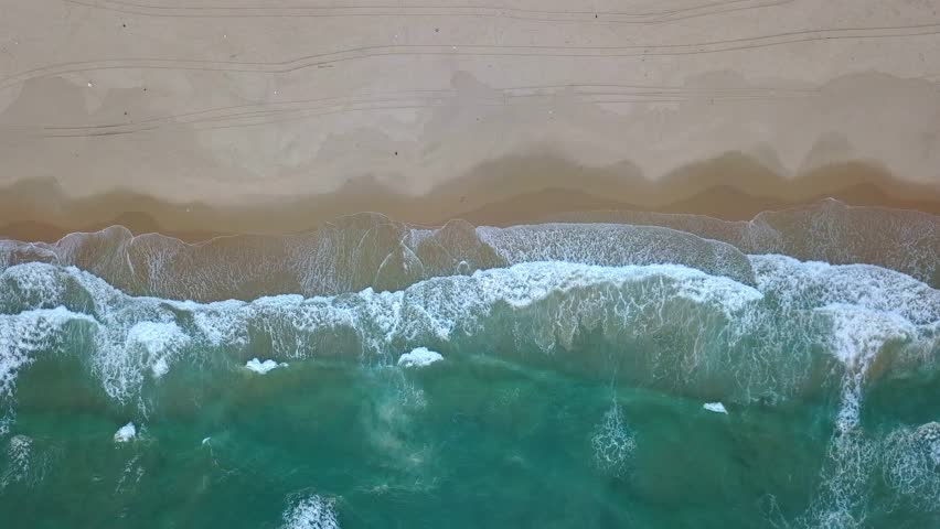 Aerial view of a pristine white sand beach at sunset (Mediterranean Sea, Israel)