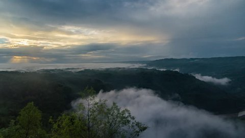 Amazing top view of misty morning at Kebun Buah Mangunan, Jogjakarta Indonesia. Tilt from right.