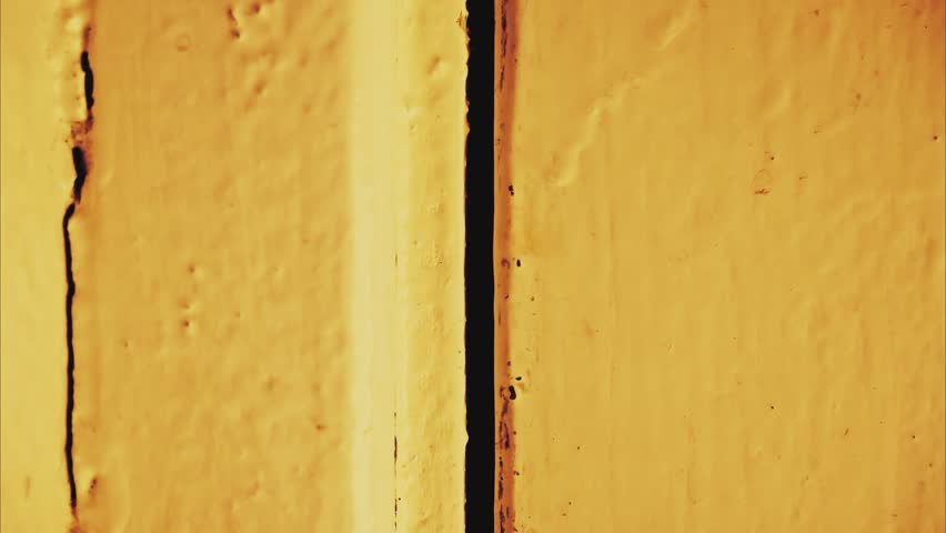 Funky art abstraction. stop motion macro hyper lapse. creative design frames animation. dynamic groovy sketch loop with room for text. vibrant yellow wooden door.   Shutterstock HD Video #1007579746