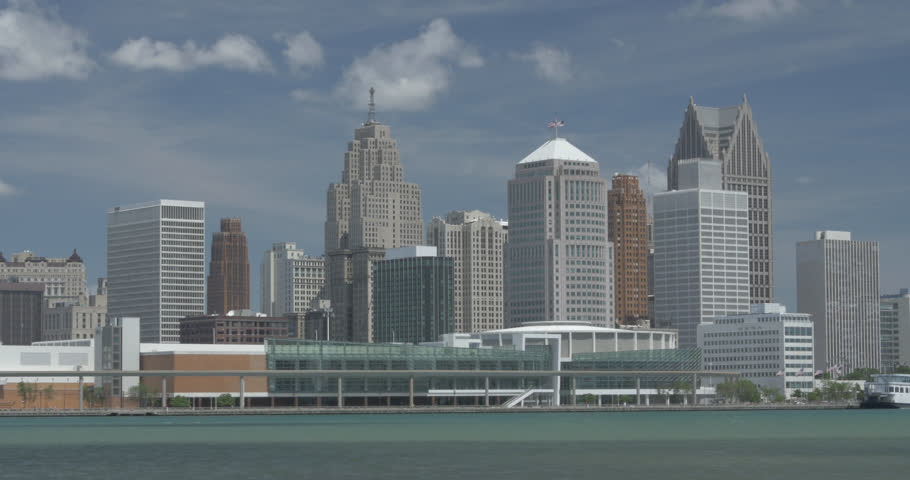 Beautiful locked off shot of Cobo Hall on the Detroit River with downtown stacked up behind on a sunny summer day.