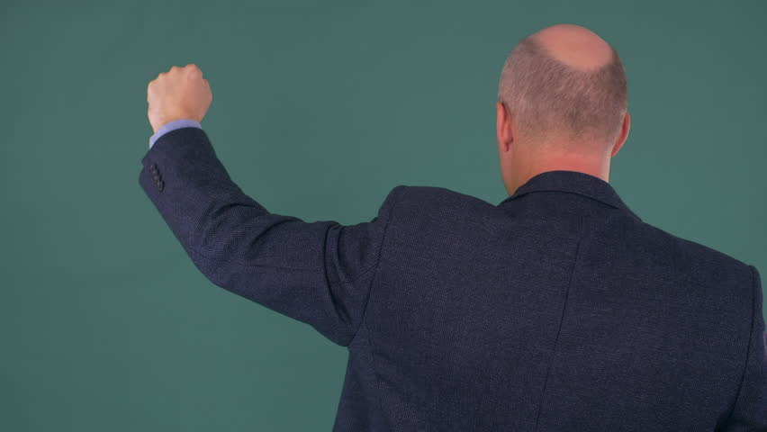 Bald businessman protesting with fist up | Shutterstock HD Video #1007601823