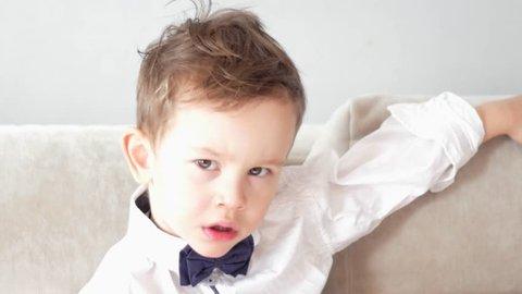cute elegant boy looking at the camera
