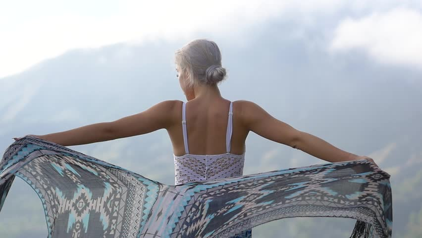 Slow motion shot of beautiful young woman enjoying the morning mountain breeze | Shutterstock HD Video #1007639938
