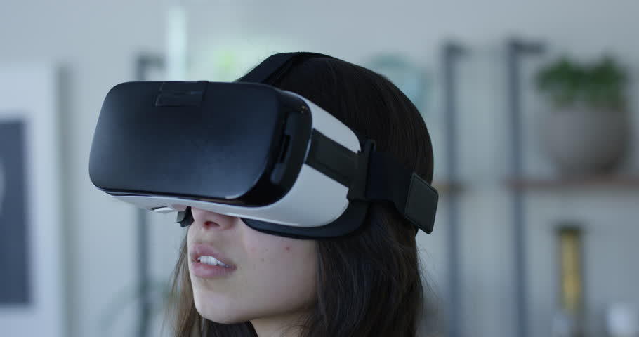 Young hip woman wearing VR 360 goggles - head on rack focus | Shutterstock HD Video #1007643187