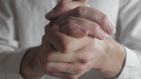 Close up Hands of caucasian man being anxious, nervous and uncomfortable.