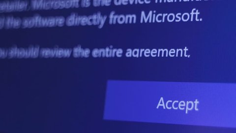 IZHEVSK, UDMURTIA - FEBRUARY 11, 2018: Microsoft user agreement. Configuring the Windows operating system. Push Accept button. Legal information and terms of use.
