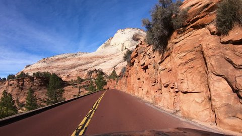 ST GEORGE, UTAH - 10 FEB: Zion National Park Utah drive car POV. Southwestern desert Utah near St George. Geological landscape wind, weather and water carved spectacular beautiful mountain valley.