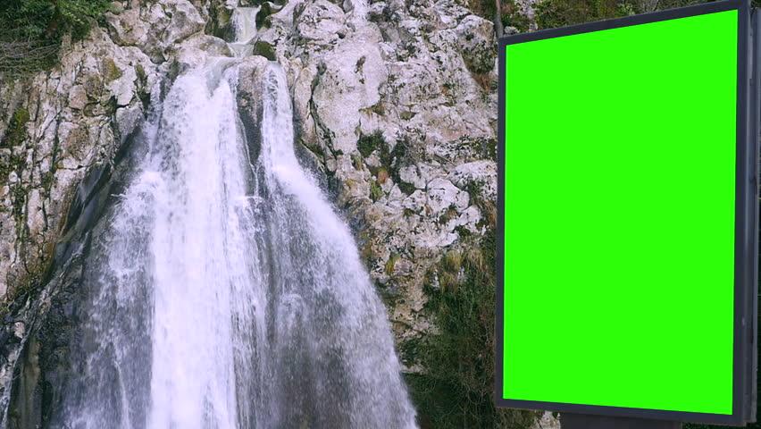 Billboard green screen near the Fabulous waterfall   Shutterstock HD Video #1007704024