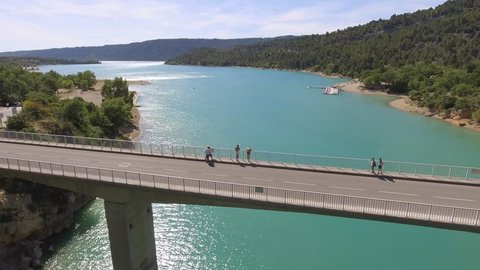 France, Provence, lake Cross, 07 June 2017: Aerial view of the magnificent bridge over the canyon and river Verdon. National park Merkantur, The young man is going to jump from the bridge