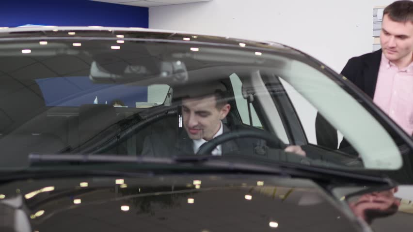 Buyer having conversation with car seller during inspecting the car | Shutterstock HD Video #1007713825