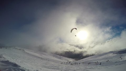"Paragliding. Caucasian mountains. Ski resort ""Rosa Khutor"". Sochi. Russia."