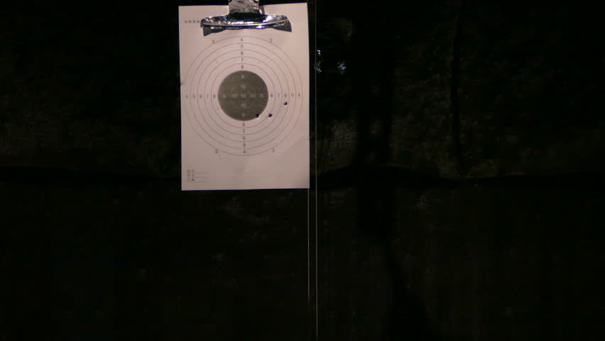 Shooting At A Target With Rifle At An Indoor Shooting Range