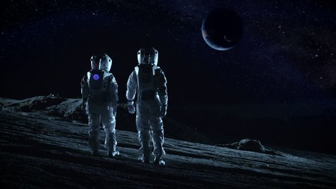 Crew of Two Astronauts in Space Suits Standing on Alien Planet and Looking at the Possibly Habitable Planet. High Tech Concept of Moon Colonization and Space Travel. Shot on RED EPIC-W 8K Helium Cinem