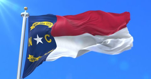 Flag of american state of North Carolina, region of the United States, waving at wind - loop