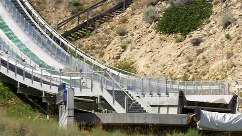 Park City, Utah, USA, July 2015. Junior nordic ski jumpers train on K120  jump at Utah Olympic Park in summer on K90 jump, venue for the 2002 Olympic Winter Games