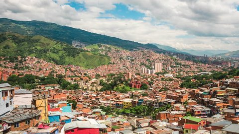 Medellin, Colombia, time lapse view over the famous Comuna 13 slums during daytime. Dolly left to right.