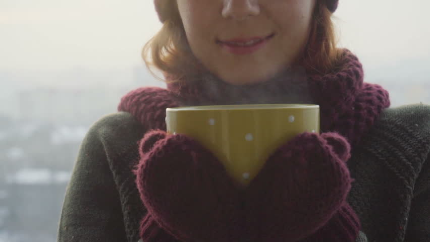Woman Drinks Hot Tea or Coffee From yellow Cup on Winter Morning | Shutterstock HD Video #1007839897