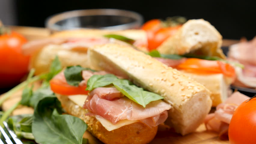 Parallax dolly shot of healthy delicous sandwich made of prosciutto, cheese and tomatoes at the kitchen   Shutterstock HD Video #1007845117