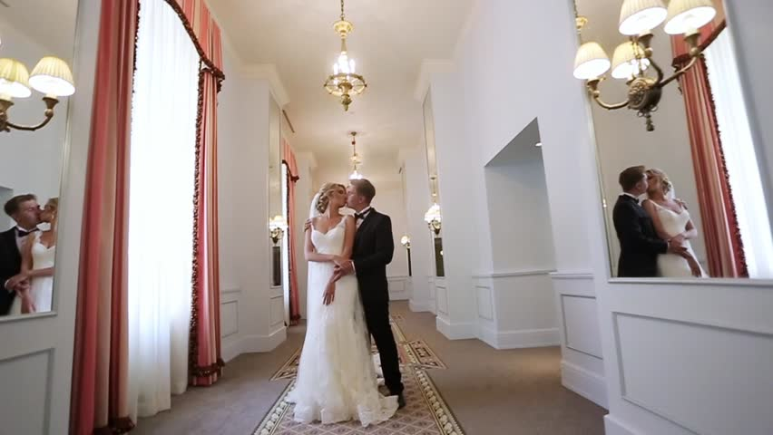 Bride and groom in palace indoors   Shutterstock HD Video #1007874757