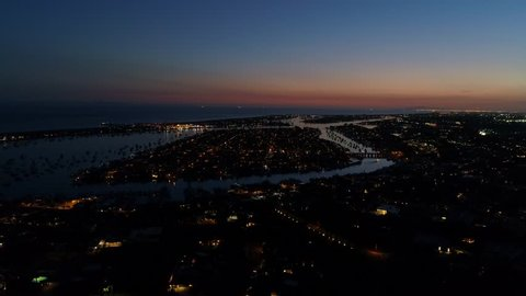 Aerial view of Balboa Island in Newport Beach harbor, California during twilight with the pink skies.