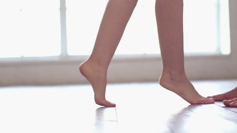 Young couple at home together saint valentine's day concept feet close-up