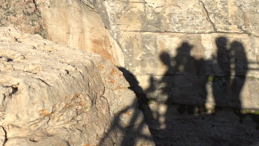 Shadow of people on rocks visiting Grand Canyon | Shutterstock HD Video #1007912707