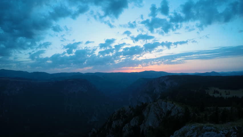 Timelapse: shot of beautiful, mountain sunrise and blue sky. Durmitor National Park, Montenegro.