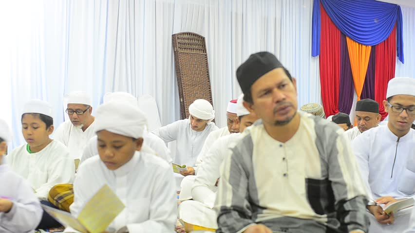 SEREMBAN,MALAYSIA - JULY 14, 2017: Malay Islamic Naming Ceremony. In malay culture, naming ceremony of baby is to introduce the baby to neighbor.baby hair will be shave and pray to god for blessing  | Shutterstock HD Video #1007958667