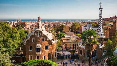 Barcelona, Spain, time lapse view of Park Guell and Barcelona cityscape at sunset. Dolly left to right.
