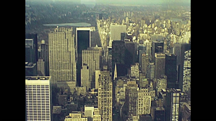 Archival Manhattan skyline aerial view from the top of Empire State Building. Old streets of old New York city, United States of America in 1981. Archival USA on 80s with bridges and skyscrapers.