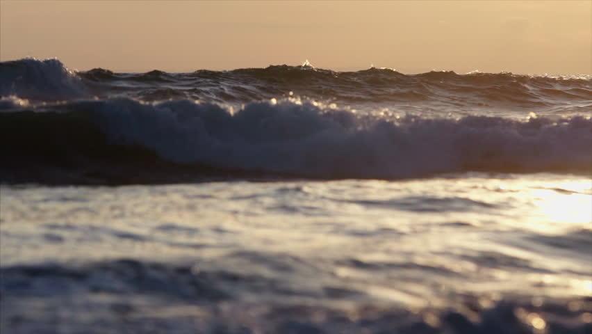 panoramic view balinese coast close-up swashing wave at sunset