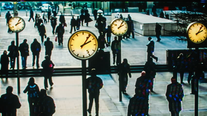Shot of business people going to work in london dockland financial district with a distortion to mkae it look like security camera footage.