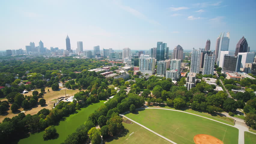 Atlanta Aerial Flying low over Piedmont Park sunny full cityscape 9/17