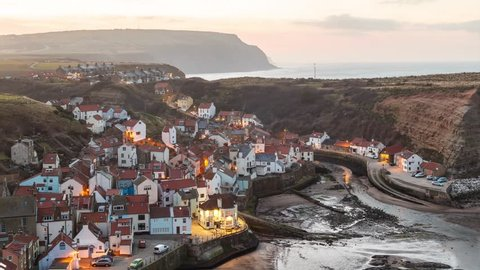Beautiful village of Staithes, North Yorkshire, England - time lapse from dusk to nighttime.