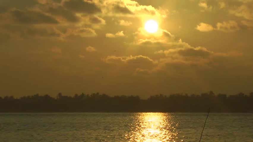 Good Morning, The Grace and Hope Of The New Day, Sunrise With Golden Color Sky and Water, The Sun Rays Reflected In River Water At Ennore, North Chennai, Tamil Nadu, India