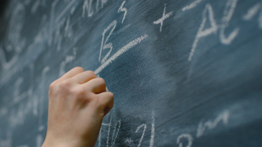 Hand Holding Chalk and Writing Complex and Sophisticated Mathematical Formula on the Blackboard. Underlining Equation. Shot on RED EPIC-W 8K Helium Cinema Camera. | Shutterstock HD Video #1008065797
