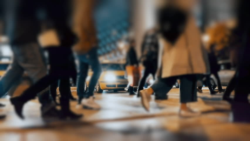 An anonymous crowd of pedestrians walking and crossing a busy city street. No logos, faces visible. Commercial shot. | Shutterstock HD Video #1008066817