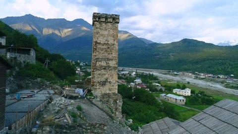 Aerial footage in Mestia v01, Georgia. Ancient historical Svaneti towers among dwelling houses