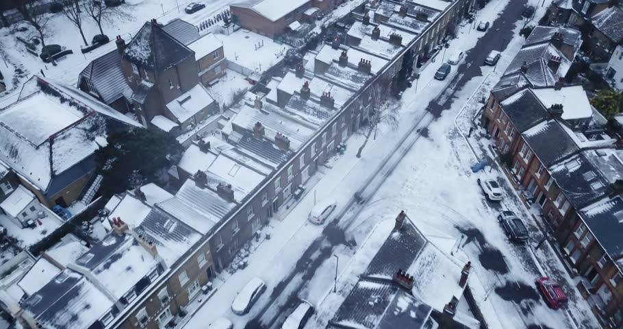 Top down drone footage of a road in South West London, England, UK during a rare snow storm in March 2018. | Shutterstock HD Video #1008132607