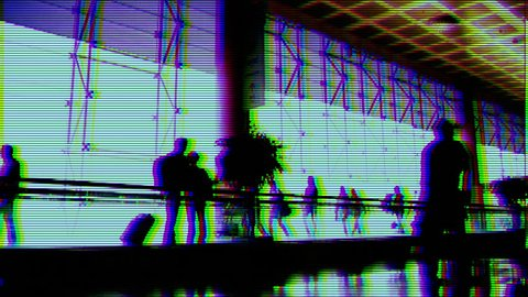 people rushing around at airport terminal with overlayed effect to make it look like cctv security footage.