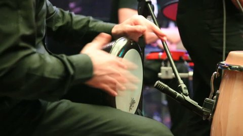 Man Is Playing Darbuka on stage.