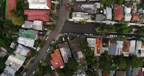 Small and large residential houses in North Sydney with local streets, parks, parked cars and backyard life style in aerial top down view.