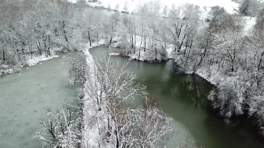 Flying over a typical winter landscape in Germany - Recorded by Allershausen, Freising, Bavaria, Germany