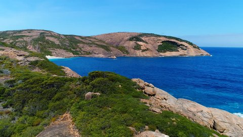 Aerial view of picturesque coastline scenery of Hellfire Bay, colorful cliffs and rocks above crystal clear waters of Southern Ocean - Cape Le Grand, Esperance, Western Australia from above, 4k UHD